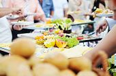 foto of catering  - people choosing food from table on catering and buffet party on business seminar conference or wedding - JPG