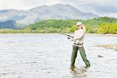 pic of fisherwomen  - fishing woman in Loch Venachar Trossachs Scotland - JPG