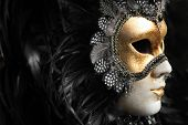 stock photo of masquerade mask  - Venetian mask decorated with gold leaf and embedded with fowl feathers - JPG
