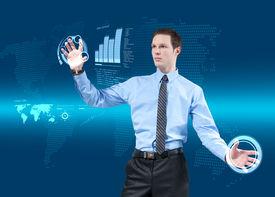 image of lightning bugs  - Young businessman navigating holographic virtual reality interface - JPG
