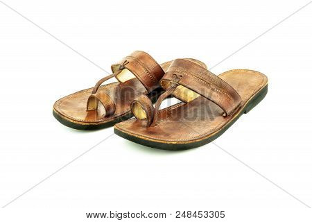 2af6ee21f6d5 Poster of Front View Of A Pair Of Brown Traditional Indian Leather Sandals  Isolated On White Background.