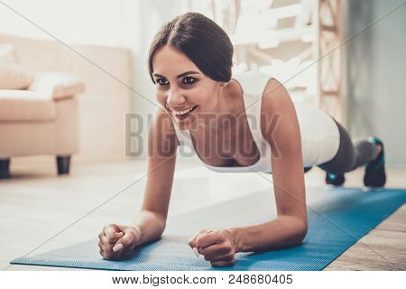 Young Smiling Woman Doing Exercises