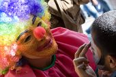 image of clown face  - Here you can see a clown painting the child - JPG