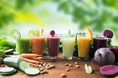 healthy eating, drinks, diet and detox concept - glasses with different fruit or vegetable juices an poster