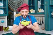 Bearded Man In Apron And Hat Loves Salad. Chef In Hat Holds Yellow Plate With Salad In Hands And Sni poster