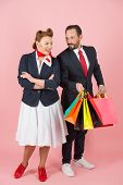 Happy Couple With Shopping Paper Bags. Man Holds Lot Of Colored Bags With Presents For Woman. Happy  poster