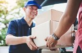 Home Delivery Service And Working Service Mind, Woman Customer Hand Receiving A Cardboard Boxes Parc poster