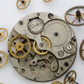 Vintage Broken Clockwork  On The White Background. Scattered Mechanisms.macro Mechanical Gear Backgr poster