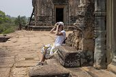 Tourist Woman Making Pictures In Pre Rup Temple, Angkor Wat Complex, Cambodia. Tourist Photographer  poster