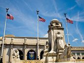 image of amtrak  - Union Station at Washington DC with Three American Flags - JPG