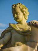 image of cherub  - Cherub in the garden of Soestdijk Palace in the Netherlands holding a scroll - JPG