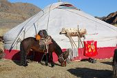 stock photo of yurt  - Inner Mongolia yurt in the grass land with mountain in background - JPG