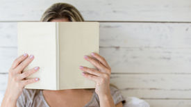 pic of incognito  - Woman reading a book and covering her face - JPG