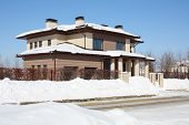 picture of peace-pipe  - Simple brown cottage with drain at frosty and sunny winter day - JPG