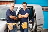 pic of plumber  - Workers In Family Business Standing Next To Van - JPG