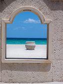 Ocean view with urn through the boardwalk window