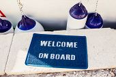 picture of coir  - Welcome aboard mat on yacht in marina - JPG
