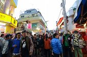 Tokyo - Nov 24 : People, Mostly Youngsters, Walk Through Takeshita Dori Near Harajuku Train Station