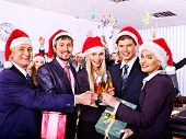 picture of office party  - Happy business group people in santa hat at Xmas party - JPG