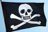 stock photo of skull crossbones flag  - Pirate flag of skull and crossbones - JPG