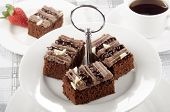 pic of cake stand  - chocolate cake on a cake stand and some coffee  - JPG
