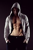 foto of hooded sweatshirt  - Body builder in hooded shirt with bare chest - JPG