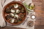 foto of artichoke hearts  - Whole and half artichokes roasted simply served with olive oil pepper and salt on the wooden table - JPG