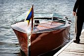 picture of dock a lake  - A docked wooden motor boat - JPG