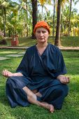pic of ayurveda  - woman meditates after an ayurveda - JPG
