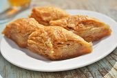 stock photo of baklava  - Turkish sweet pastry baklava on a plate closeup - JPG