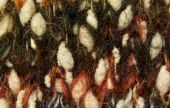 stock photo of villi  - dyed wool texture background with visible threads - JPG