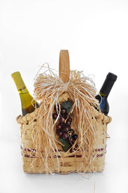 picture of gift basket  - red and white wine bottles in a decorative basket for gift giving  - JPG