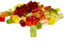pic of gummy bear  - green bear with other multi colored gummy Bears isolated on white - JPG