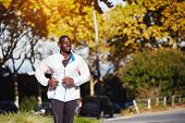 image of dark-skin  - dark skinned athlete running fast at evening outdoors
