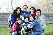 foto of family fun  - Beautiful Interracial family of seven outdoors in summer - JPG