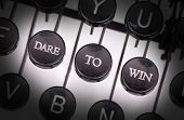 foto of daring  - Typewriter with special buttons dare to win - JPG