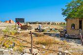 image of shacks  - The shack in the wasteland next to the luxury Marina of Hurghada Egypt - JPG