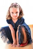 stock photo of little girls photo-models  - Little cute girl posing while wearing her mother - JPG