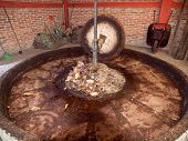 image of mezcal  - Press of natural stone for the preparation of raw materials to factory Mezcal - JPG