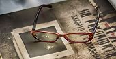 foto of bifocals  - Book and a pair of glasses above - JPG