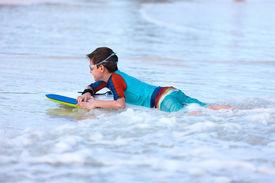 image of boogie board  - Little boy on vacation having fun surfing on boogie board - JPG
