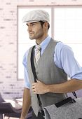 picture of leaving  - Stylish young caucasian businessman in cap leaving office - JPG