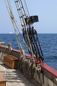 picture of tall ship  - Rigging of a tall ship against blue sky and sea - JPG