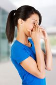image of sinus  - Young woman with sinus pressure pain - JPG