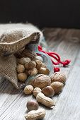 stock photo of ground nut  - Bag full of bio nuts and almonds - JPG