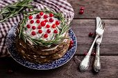 image of hepatitis  - the hepatic pie decorated with berries and rosemary on a wooden table - JPG
