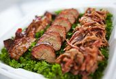 picture of pork belly  - BBQ Pork butt on a bed of parsley  - JPG
