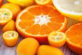 stock photo of kumquat  - Fresh tangerine kumquat and lemon on table selective focus  - JPG