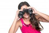 picture of binoculars  - Beautiful teenage girl looking through a pair of binoculars isolated on white - JPG