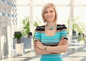 pic of cross-dress  - Happy blond female office worker standing arms crossed at office - JPG